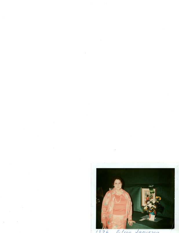 Color photo of Eileen Jamieson with painting at artist's reception.jpg